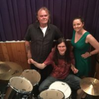 Cornish energy firm donates drum kit to charity